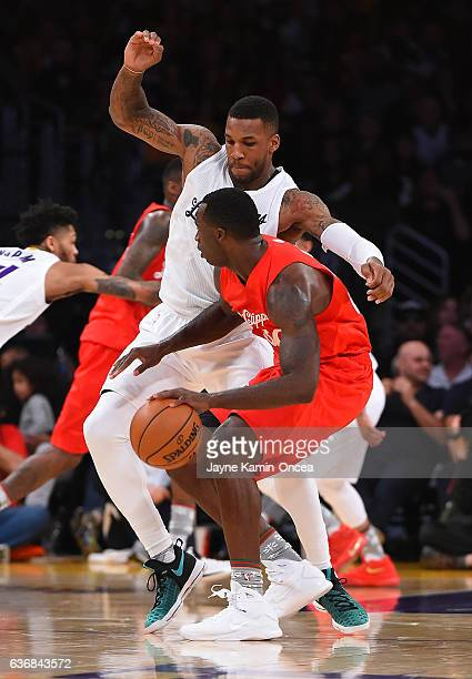 Thomas Robinson of the Los Angeles Lakers guards Brandon Bass of the Los Angeles Clippers during the game at Staples Center on December 25 2016 in...