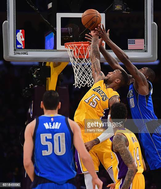 Thomas Robinson of the Los Angeles Lakers has jumps for a rebound with Dorian FinneySmith of the Dallas Mavericks at Staples Center on December 29...