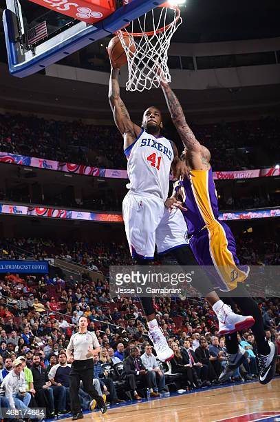 Thomas Robinson of the Philadelphia 76ers dunks the ball against the Los Angeles Lakers at Wells Fargo Center on March 30 2015 in Philadelphia...