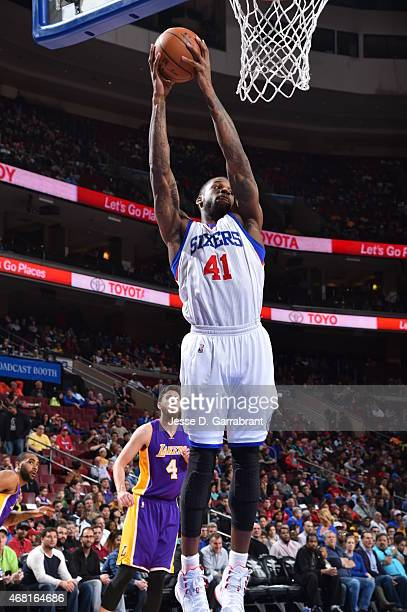 Thomas Robinson of the Philadelphia 76ers grabs the rebound against the Los Angeles Lakers at Wells Fargo Center on March 30 2015 in Philadelphia...