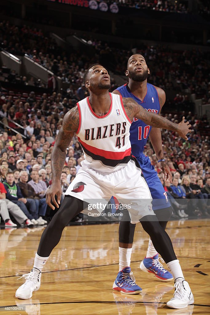 Thomas Robinson #41 of the Portland Trail Blazers boxes out <a gi-track='captionPersonalityLinkClicked' href=/galleries/search?phrase=Greg+Monroe&family=editorial&specificpeople=5042440 ng-click='$event.stopPropagation()'>Greg Monroe</a> #10 of the Detroit Pistons on November 11, 2013 at the Moda Center Arena in Portland, Oregon.
