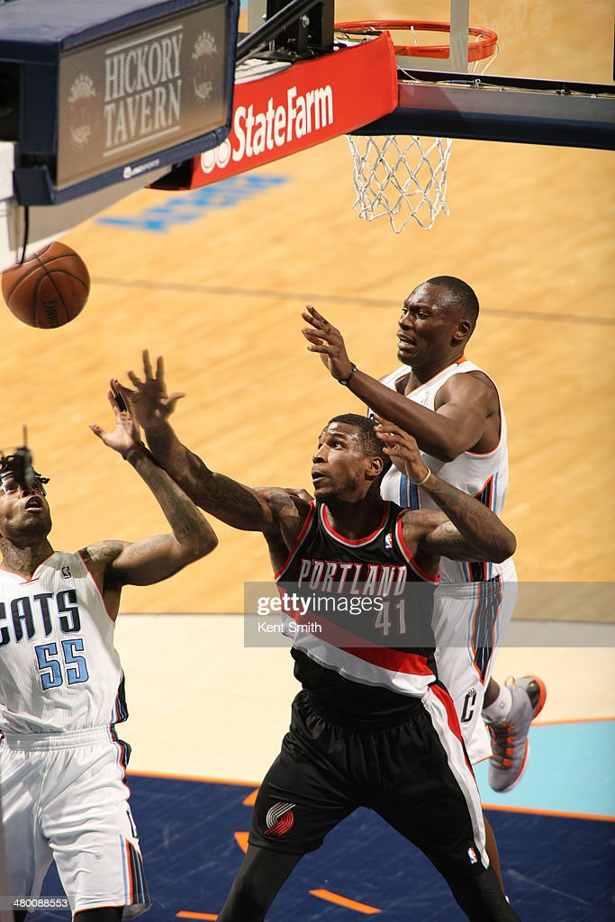 Thomas Robinson #41 of the Portland Trail Blazers goes for the ball against Chris Douglas-Roberts #55 of the Charlotte Bobcats at the Time Warner Cable Arena on March 22, 2014 in Charlotte, North Carolina.