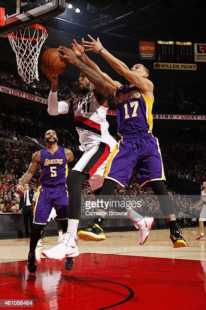 Thomas Robinson of the Portland Trail Blazers goes to the basket against Jeremy Lin of the Los Angeles Lakers on January 5 2015 at the Moda Center in...