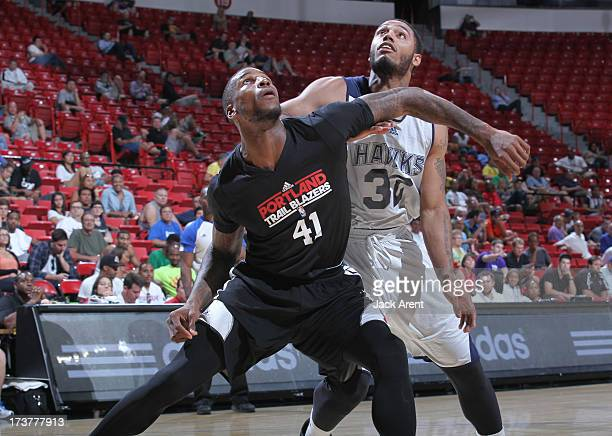 Thomas Robinson of the Portland Trail Blazers guards Mike Scott of the Atlanta Hawks during the NBA Summer League game between the Atlanta Hawks and...