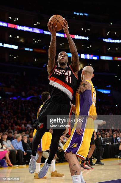 Thomas Robinson of the Portland Trail Blazers shoots against Robert Sacre of the Los Angeles Lakers at Staples Center on April 1 2014 in Los Angeles...