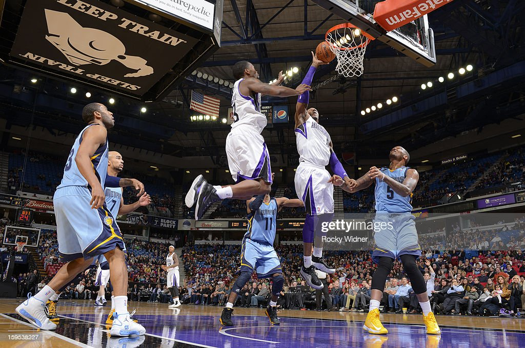 Thomas Robinson #0 of the Sacramento Kings attempts to tip the ball in against <a gi-track='captionPersonalityLinkClicked' href=/galleries/search?phrase=Marreese+Speights&family=editorial&specificpeople=4187263 ng-click='$event.stopPropagation()'>Marreese Speights</a> #5 of the Memphis Grizzlies on January 7, 2013 at Sleep Train Arena in Sacramento, California.