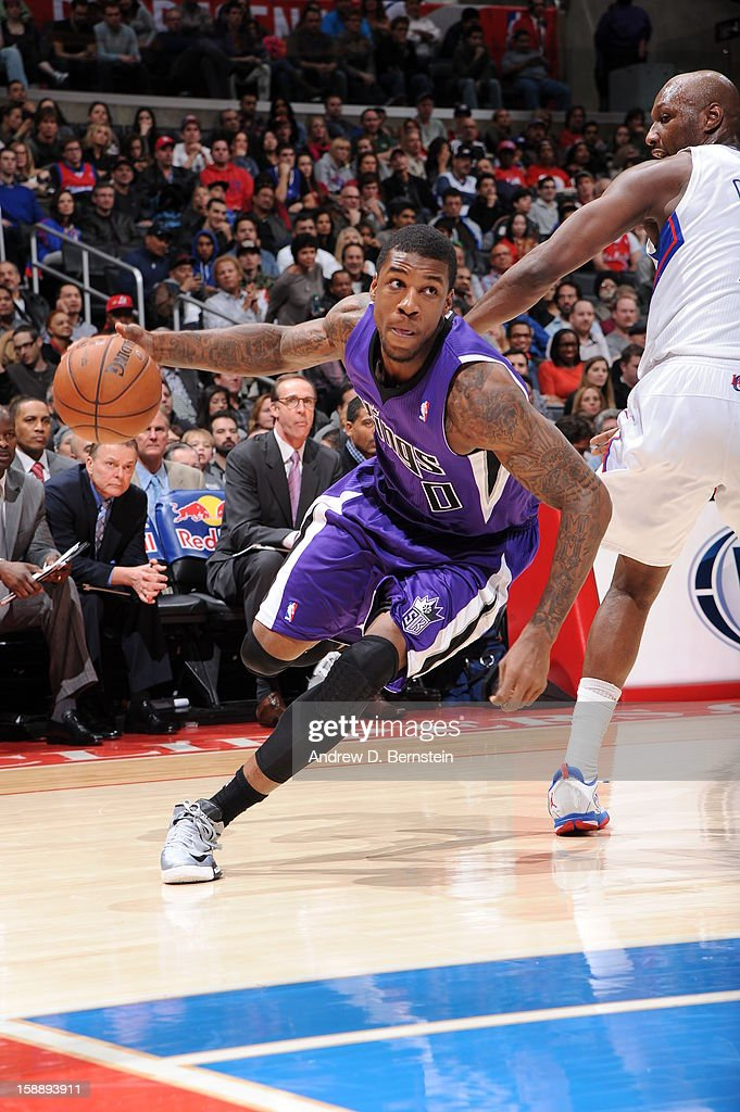 Thomas Robinson #0 of the Sacramento Kings drives to the basket against Lamar Odom #7 of the Los Angeles Clippers at Staples Center on December 21, 2012 in Los Angeles, California.