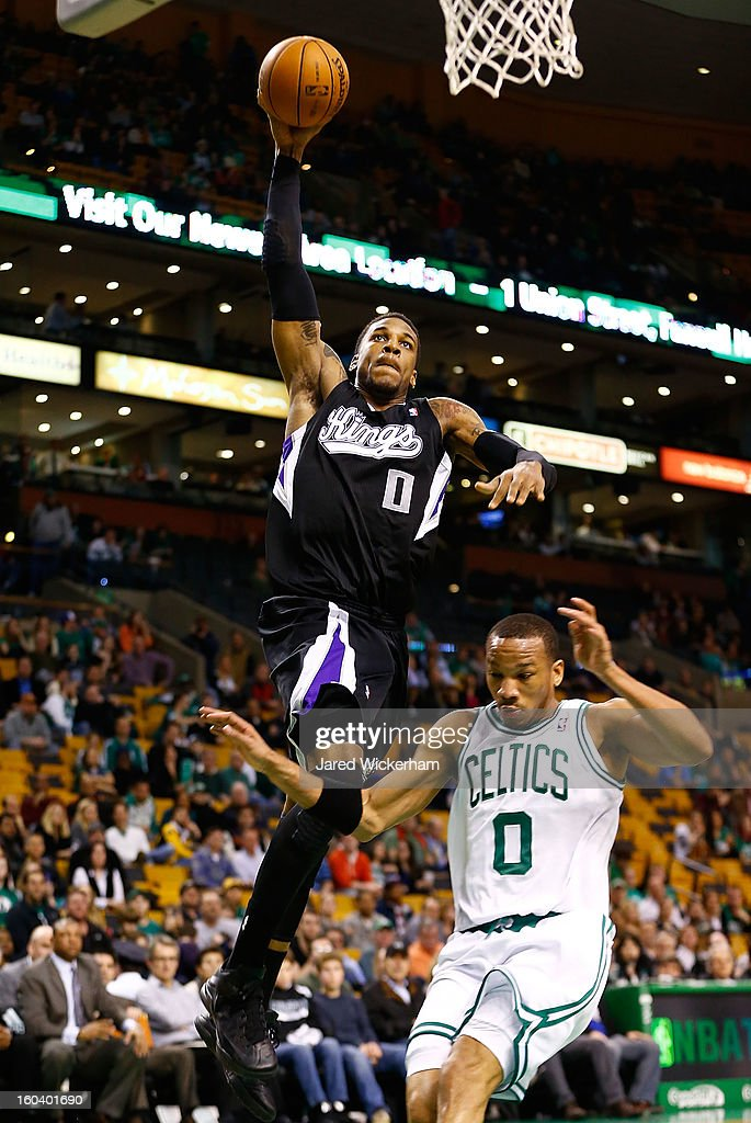 Thomas Robinson #0 of the Sacramento Kings dunks over <a gi-track='captionPersonalityLinkClicked' href=/galleries/search?phrase=Avery+Bradley&family=editorial&specificpeople=5792051 ng-click='$event.stopPropagation()'>Avery Bradley</a> #0 of the Boston Celtics during the game on January 30, 2013 at TD Garden in Boston, Massachusetts.