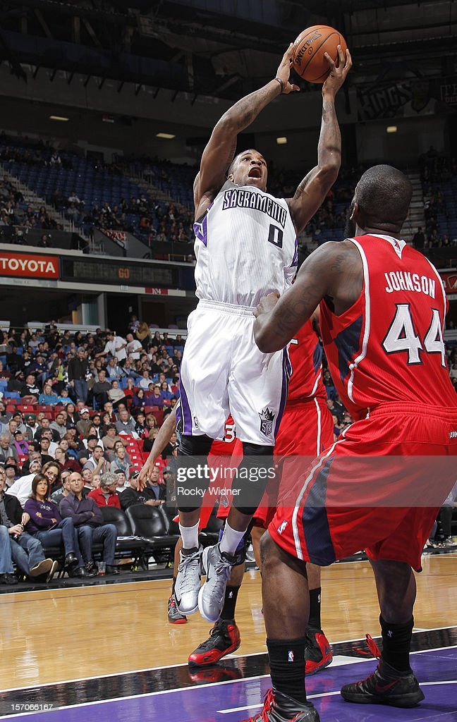 Thomas Robinson #0 of the Sacramento Kings goes up for the shot against Ivan Johnson #44 of the Atlanta Hawks on November 16, 2012 at Sleep Train Arena in Sacramento, California.