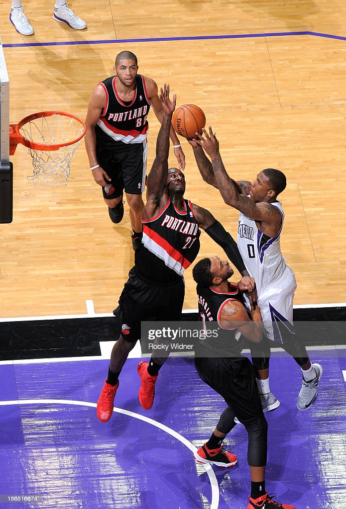 Thomas Robinson #0 of the Sacramento Kings grabs the rebound away from <a gi-track='captionPersonalityLinkClicked' href=/galleries/search?phrase=J.J.+Hickson&family=editorial&specificpeople=4226173 ng-click='$event.stopPropagation()'>J.J. Hickson</a> #21 of the Portland Trail Blazers on November 13, 2012 at Sleep Train Arena in Sacramento, California.