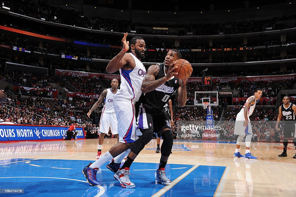 Thomas Robinson #0 of the Sacramento Kings puts up a shot against <a gi-track='captionPersonalityLinkClicked' href=/galleries/search?phrase=Ronny+Turiaf&family=editorial&specificpeople=224998 ng-click='$event.stopPropagation()'>Ronny Turiaf</a> #21 of the Los Angeles Clippers at Staples Center on December 1, 2012 in Los Angeles, California.