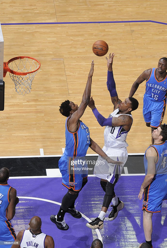 Thomas Robinson #0 of the Sacramento Kings shoots against <a gi-track='captionPersonalityLinkClicked' href=/galleries/search?phrase=Hasheem+Thabeet&family=editorial&specificpeople=4003778 ng-click='$event.stopPropagation()'>Hasheem Thabeet</a> #34 of the Oklahoma City Thunder on January 25, 2013 at Sleep Train Arena in Sacramento, California.