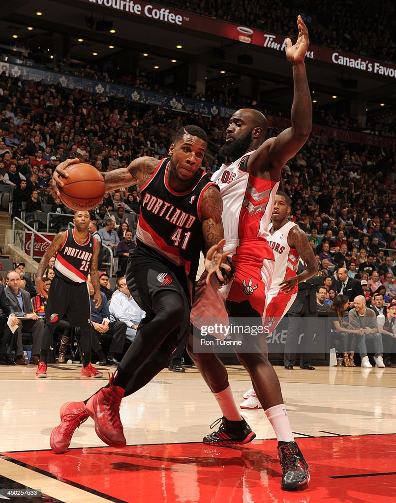 Thomas Robinson #41 of the Toronto Raptors dribbles baseline against the Portland Trail Blazers during the game on November 17, 2013 at the Air Canada Centre in Toronto, Ontario, Canada.