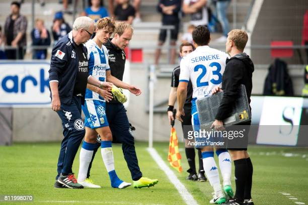 Thomas Rogne of IFK Goteborg leaves the pitch injured during the Allsvenskan match between IFK Goteborg and Halmstad BK at Gamla Ullevi on July 10...