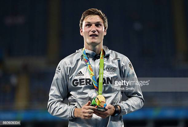Thomas Rohler of Germany stands on the podium during the medal ceremony for the Men's Javelin Throw on Day 15 of the Rio 2016 Olympic Games at the...