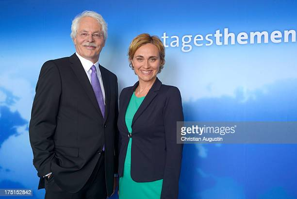Thomas Roth and Caren Miosga attend a photocall to introduce new 'Tagesthemen' Host Thomas Roth at Le Royal Meridien Hamburg on August 1 2013 in...