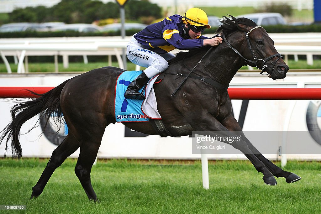 Thomas Sadler riding African Pulse winning the Bert Bryant Handicap during Melbourne Racing at Caulfield Racecourse on March 30, 2013 in Melbourne, Australia.