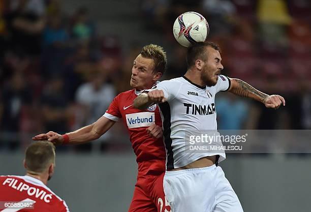 Thomas Salomon of FK Austria Wien vies for the ball with Denis Alibec of FC Astra Giurgiu during the UEFA Europa League Group E football match FC...