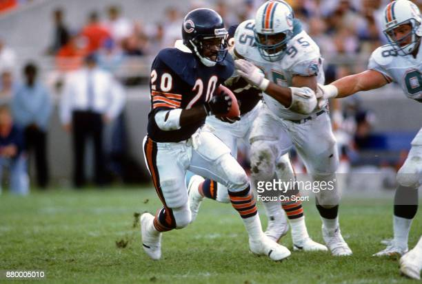 Thomas Sanders of the Chicago Bears carries the ball against the Miami Dolphins during an NFL football game September 4 1988 at Soldier Field in...