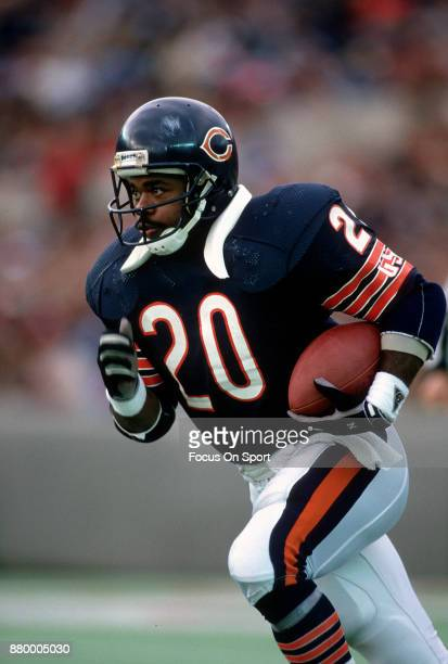 Thomas Sanders of the Chicago Bears carries the ball during an NFL football game circa 1988 at Soldier Field in Chicago Illinois Sanders played for...