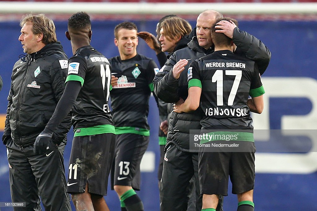 <a gi-track='captionPersonalityLinkClicked' href=/galleries/search?phrase=Thomas+Schaaf&family=editorial&specificpeople=216597 ng-click='$event.stopPropagation()'>Thomas Schaaf</a> (2ndR), head coach of Bremen of Bremen hugs <a gi-track='captionPersonalityLinkClicked' href=/galleries/search?phrase=Aleksandar+Ignjovski&family=editorial&specificpeople=6129439 ng-click='$event.stopPropagation()'>Aleksandar Ignjovski</a> (R) of Bremen after the Bundesliga match between VfB Stuttgart and Werder Bremen at Mercedes-Benz Arena on February 9, 2013 in Stuttgart, Germany.