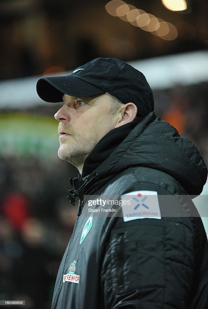 Thomas Schaaf, head coach of Bremen ponders during the Bundesliga match between SV Werder Bremen and Hannover 96 at Weser Stadium on February 1, 2013 in Bremen, Germany.