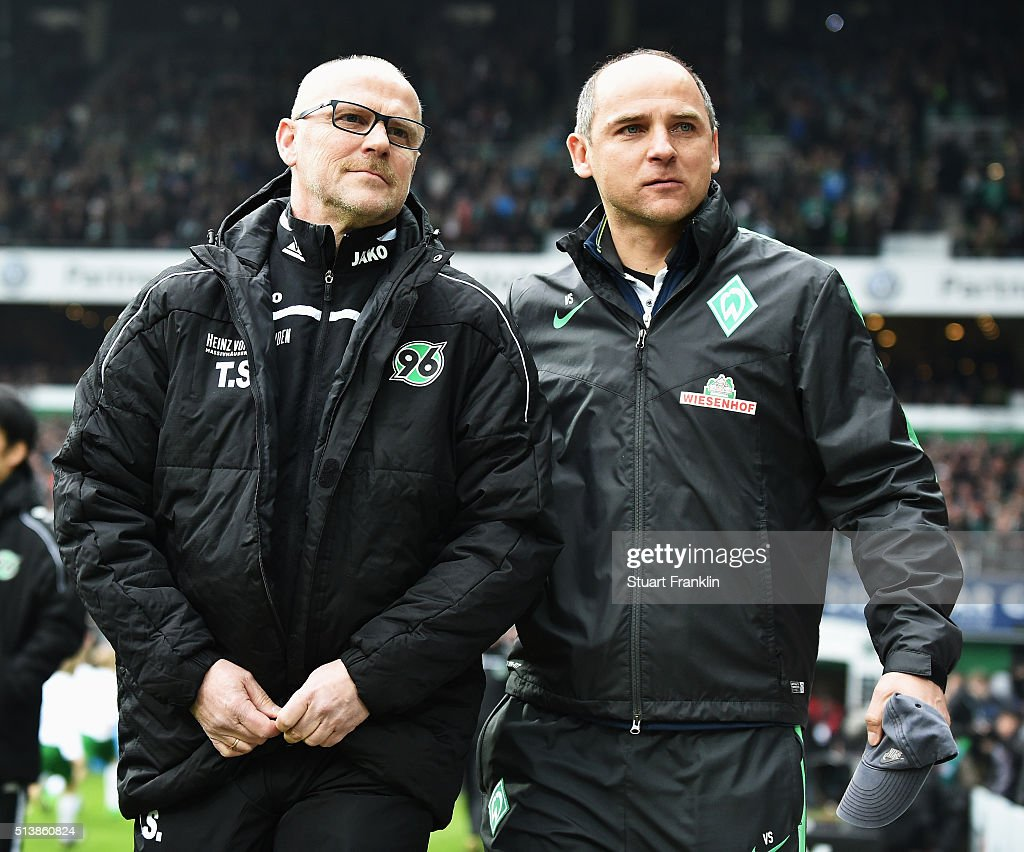 Thomas Schaaf head coach of Hannover walks out with Viktor Skripnik head coach of Bremen during the Bundesliga match between Werder Bremen and...