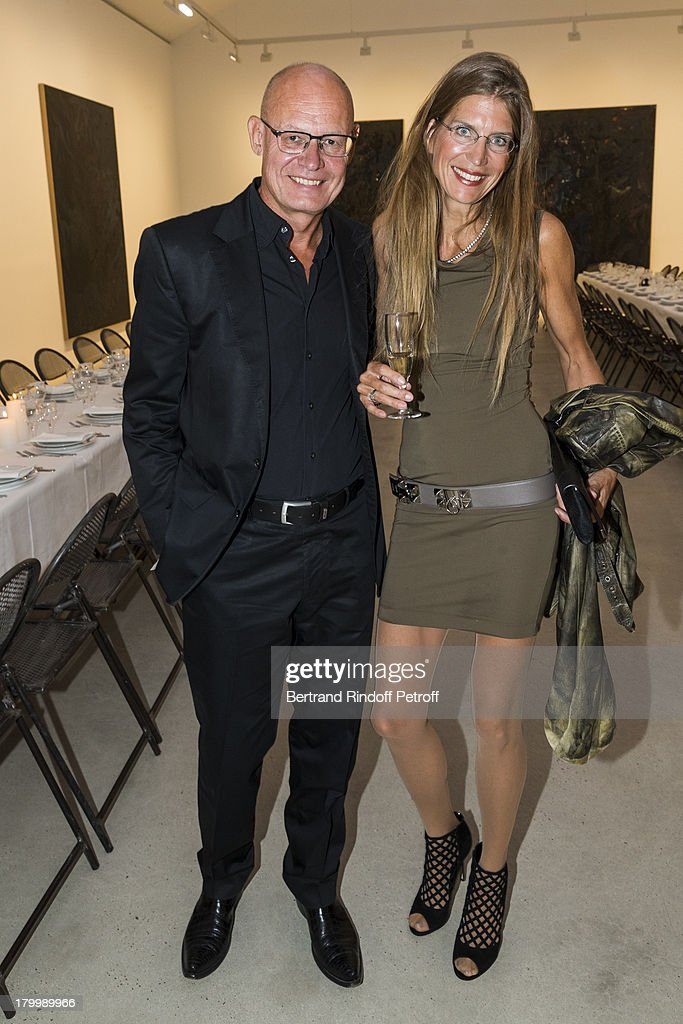 Thomas Schlytter-Henrich (L) and his wife Simone attend the Georg Baselitz exhibition preview and dinner at Thaddeus Ropac Gallery on September 7, 2013 in Pantin, east of Paris, France. The exhibition opens on September 8.