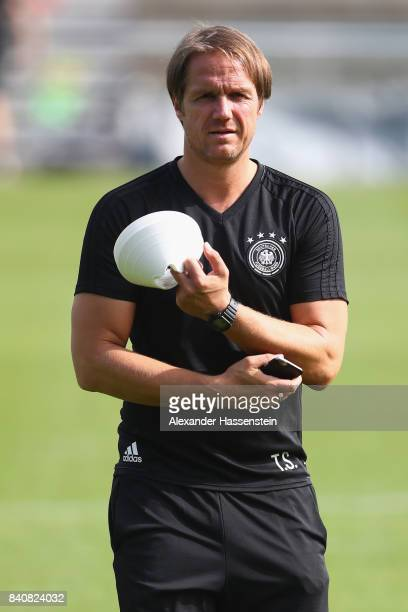 Thomas Schneider assistent coach of Germany looks on during a training session of the German National team at RobertSchlienzStadion on August 30 2017...