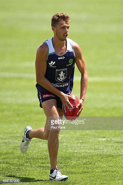 Thomas Sheridan of the Dockers looks to pass the ball during a Fremantle Dockers AFL preseason training session at Fremantle Oval on December 1 2014...