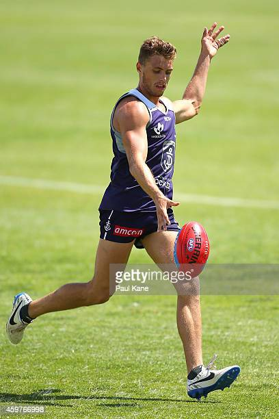 Thomas Sheridan of the Dockers passes the ball during a Fremantle Dockers AFL preseason training session at Fremantle Oval on December 1 2014 in...