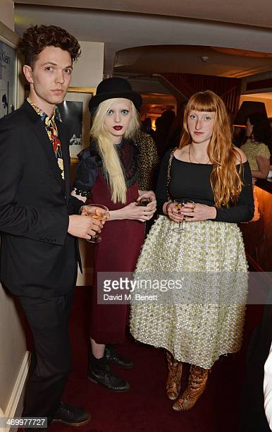 Thomas Shickle Esmeralda and Molly Goddard attend the launch of LOVE special editions at George on February 17 2014 in London England
