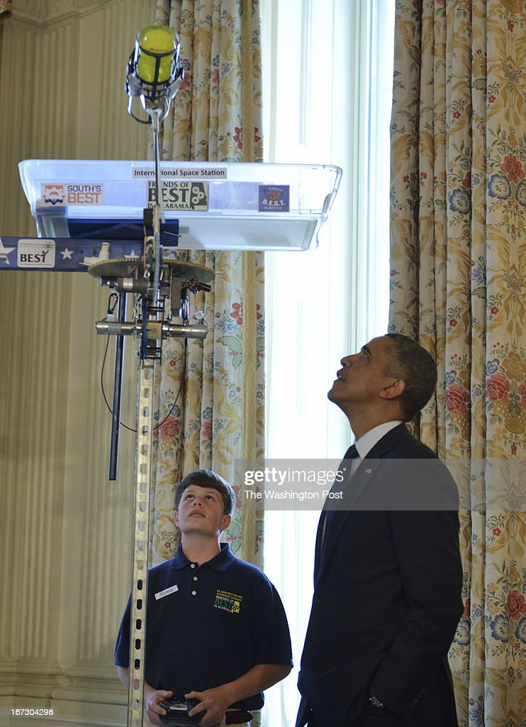 "Thomas Shields,13 and his teammates of Theodore, Alabama , (not shown) gives President Barack Obama a demonstration in robotics in the State Dining Room of the White House in Washington, D.C. on April 22, 2013. This team won BEST Robotics As the smallest middle school in a field of 57 competitors that were mostly high schools, odds were against the St Vincent de Paul BEST Robotics Team from Theodore, Alabama. Yet their remarkable robot, ""Vator"" (short for Ele-Vator), which was designed to mimic space elevators by carrying cargo up a 10 foot pole, emerged triumphant, winning a 1st Place Robot Award. For Victoria Fletcher (13), Rush Lyons (14), Thomas Shields (13) and their teammates, the experience of designing a product and marketing it to judges not only reinforced the value of teamwork, but demonstrated the applications that science and math can have on Earth and beyond. President Barack Obama hosts the White House Science Fair to celebrate the student winners of a broad range of science, technology, engineering and math (STEM) competitions from across the country."