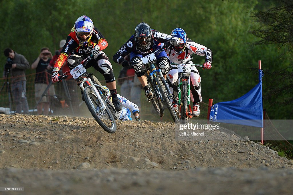 Thomas Slavik, David Graff and Michal Propkop compete in the men's four cross pro tour final at the UCI Mountain Bike World Cup on June 8, 2013 in Fort William, Scotland.