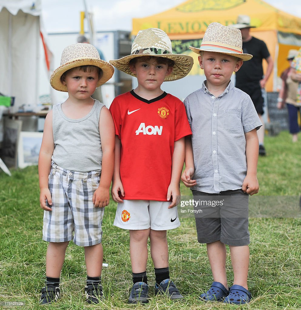 Thomas Smith, 3, Terence Lee-Calvert, 4, and James Calvert, 3, from Stokesley visit the steam rally at Duncombe Park on July 7, 2013 in Helmsley, England. The popular steam rally takes place in the magnificant grounds of the park over the first weekend of July each year and brings together traction engines, working displays, vintage tractors, commercial and military vehicles, vintage cars and motorcycles.