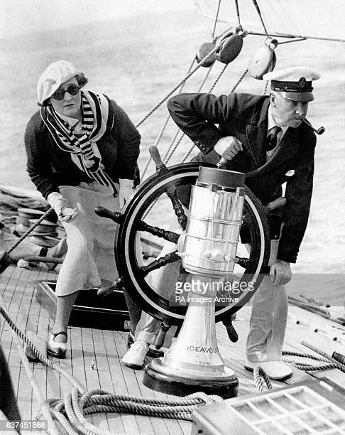 Thomas Sopwith right and his wife Phyllis at the wheel of his yacht Endeavour a 130foot J Class sloop