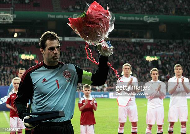 Thomas Sorensen of Denmark accepts an award for his 100th international cap during the International Friendly between Denmark and Russia at Parken...
