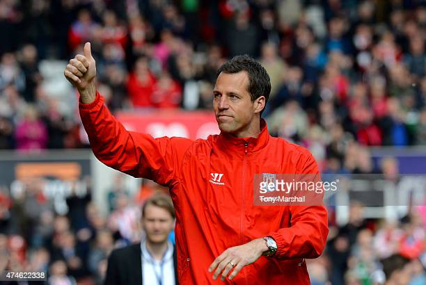 Thomas Sorensen of Stoke City applauds the fans on a lap of honour after the Barclays Premier League match between Stoke City and Liverpool at...