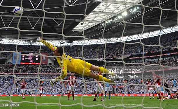 Thomas Sorensen of Stoke City makes a save during the The FA Cup sponsored by E0N 2011 Final match between Manchester City and Stoke City at Wembley...