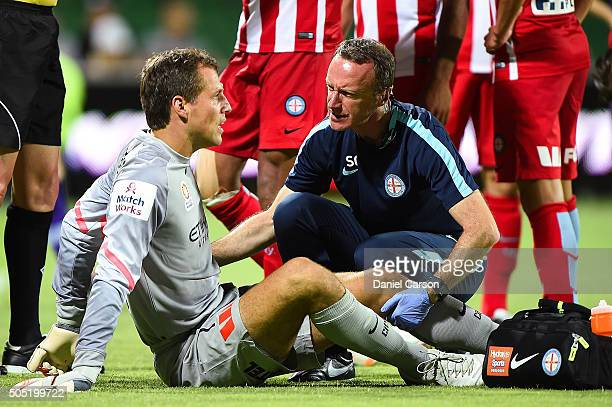 Thomas Sorensen of the Melbourne City FC is attended to by the trainer during the round 15 ALeague match between Perth Glory and Melbourne City FC at...