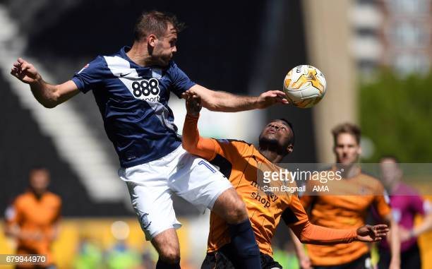 Thomas Spurr of Preston North End and Bright Enobakhare of Wolverhampton Wanderers during the Sky Bet Championship match between Wolverhampton...