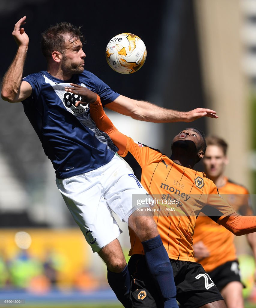 Thomas Spurr of Preston North End and Bright Enobakhare of Wolverhampton Wanderers during the Sky Bet Championship match between Wolverhampton Wanderers and Preston North End at Molineux on May 7, 2017 in Wolverhampton, England.