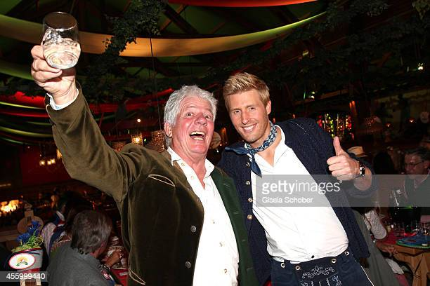 Thomas Stein Maxi Arland attend the 'GoldStar TV Wiesn' during Oktoberfest at Weinzelt Theresienwiese on September 23 2014 in Munich Germany