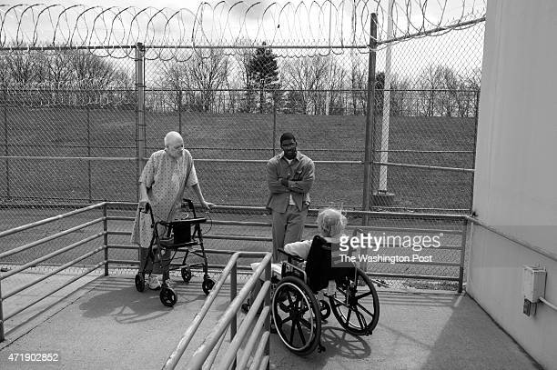 Thomas Syfor Tyrell Wells and Leon Swichkow chat in the sunshine at Devens federal prison in Massachusetts on Tuesday April 21 2015 Wells works as a...