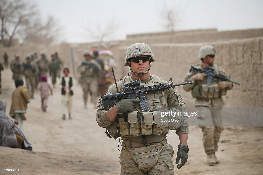 Thomas Taylor from Swansea South Carolina with the US Army's 4th squadron 2d Cavalry Regiment participates in a joint patrol through a village with...