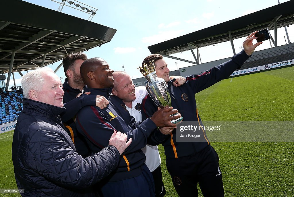 Thomas Telford School coaching staff poses with the trophy during the under 16 Schools' Cup final match between Thomas Telford School and Samuel Whitbread Academy at the Academy Training Ground on May 04, 2016 in Manchester, England.