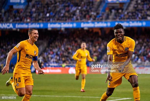Thomas Teye Partey and Gabi Fernandez of Atletico de Madrid celebrate the 0 1 goal during the La Liga match between Deportivo La Coruna and Atletico...