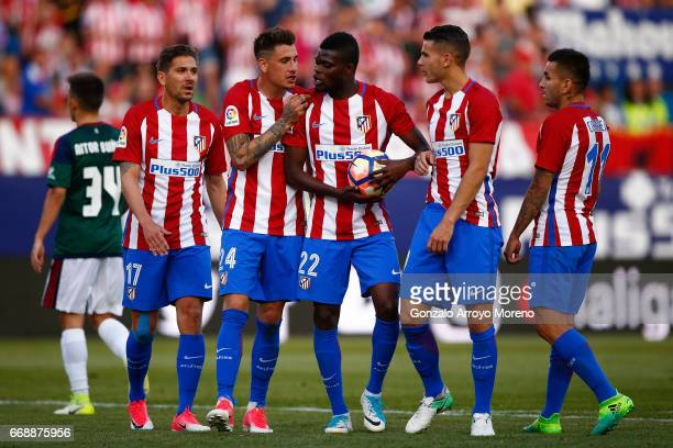 Thomas Teye Partey of Atletico de Madrid argues with his teammates Jose Maria Gimenez Alessio Cerci Lucas Hernandez and Angel Martin Correa before...
