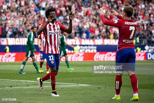 Thomas Teye Partey of Atletico de Madrid celebrates scoring their fifth goal with teammate Antoine Griezmann during the La Liga match between Club...