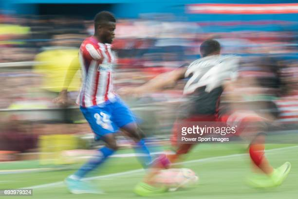 Thomas Teye Partey of Atletico de Madrid fights for the ball with Mikel Balenziaga Oruesagasti of Athletic Club during the La Liga match between...